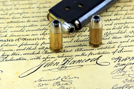 Ammunition on US Constitution John Hancock's signature  - The Right to Bear Arms