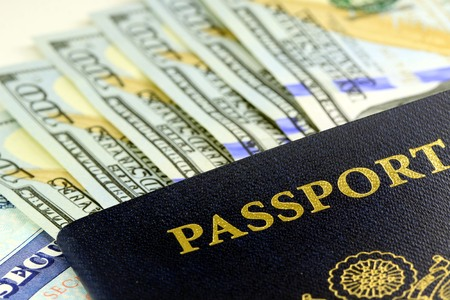american currency: Travel Documents - USA Passport with American Currency Stock Photo