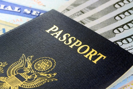 Travel Documents - USA Passport with American Currency Stok Fotoğraf