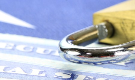 Padlock and social security card - Identity theft and identity protection concept