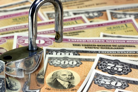 United States Savings Bonds with padlock - Financial security concept