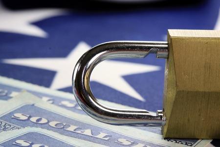 identity protection: Padlock and social security card - Identity theft and identity protection concept