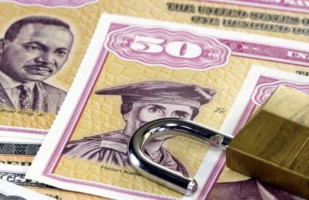 bonds: United States Savings Bonds with padlock - Financial security concept