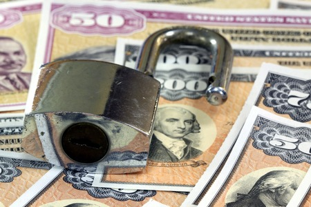 financial security: United States Savings Bonds with padlock - Financial security concept