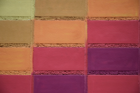 commissioned: Painted multi-colored brick. Stock Photo