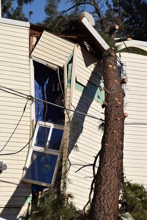 high winds: Storm damage on apartment coplex.