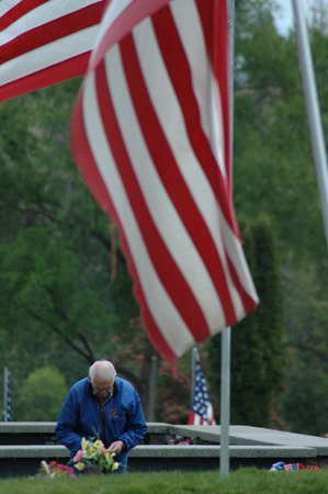 remembering: Man remembering on Memorial Day. Editorial