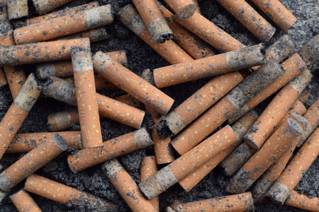 Cigarette butts on sidewalk. Stockfoto