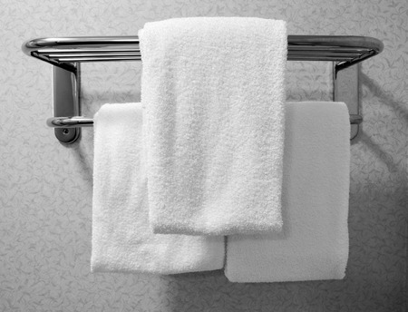 impersonal: Trio of Bathroom towels in a chain hotel. Stock Photo