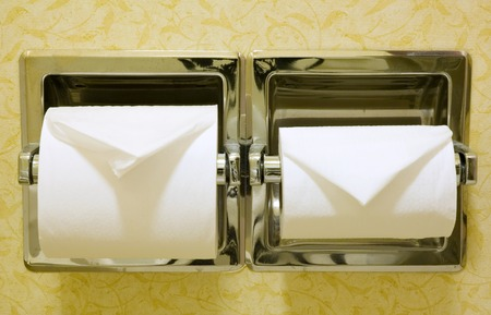 impersonal: Dual rolls of toilet paper, in a hotel room