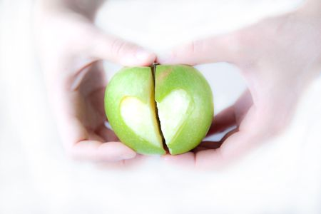 Apple in the hands Stock Photo - 6402354
