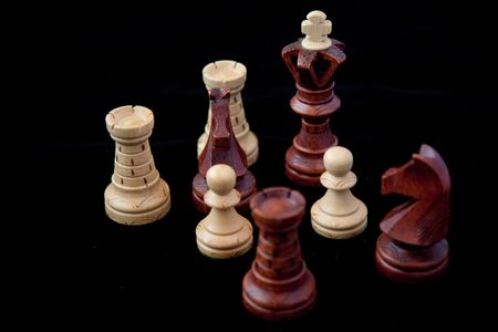 gamesmanship: Black and white chess piece on a black background