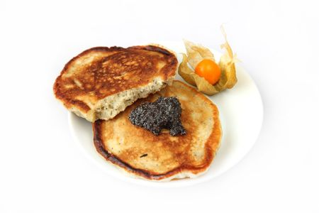 freshly prepared: Tow freshly prepared pancakes with poppy souse