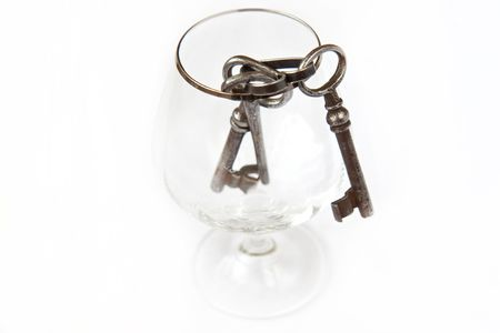 passkey: Three old keys in a glass Stock Photo