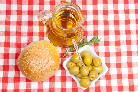 Green olives with olive oil and fresh bread  photo