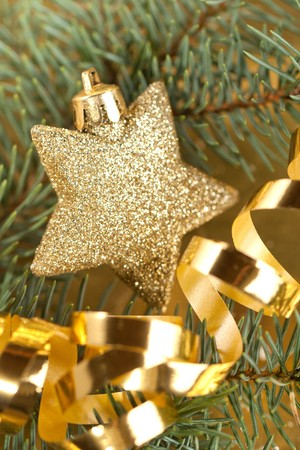 Shining golden christmas star with christmas tree and golden tape photo