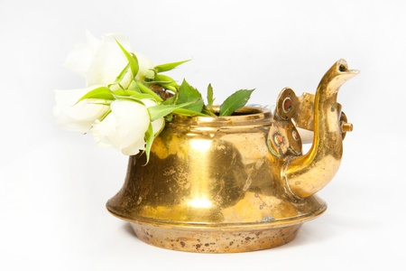 teakettle: Old teapot with white roses on the white background Stock Photo