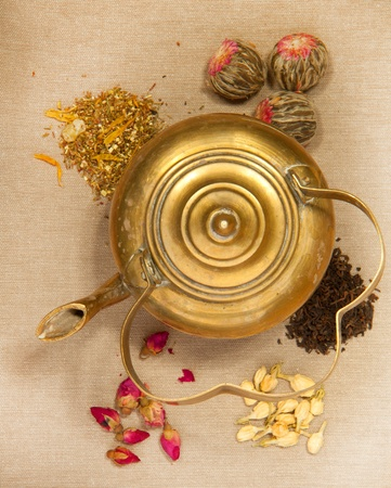 Old teapot with mix of tea photo