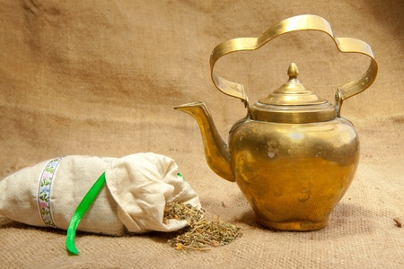 Old teapot and sack of tea Stock Photo - 8357171