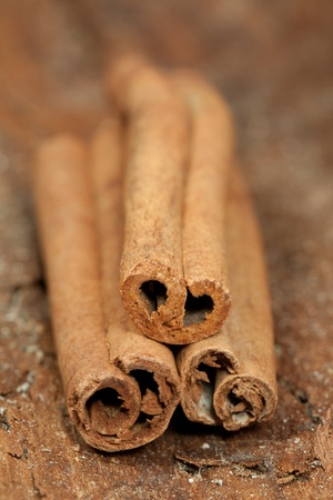 cinnamon pile on the wood photo