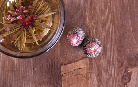 Transparent cup of green tea on the wooden table photo