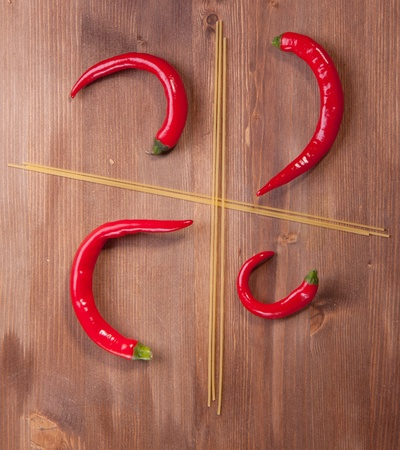 Four section from spaghetti with red hot chilli peppers photo
