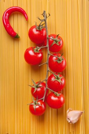 Composition of pasta, pepper, onion and tomato photo