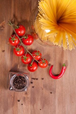 Composition of tow kind of pepper,  italian pasta and tomato cherry photo