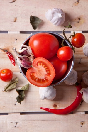 Tomato, garlic and pepper on a wooden desk photo