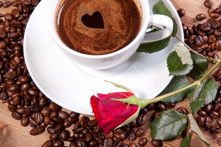 White cup of black coffee with little heart on coating. For themes like love, valentine's day