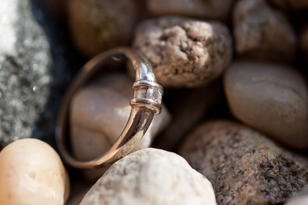 Diamond ring on sea stones photo
