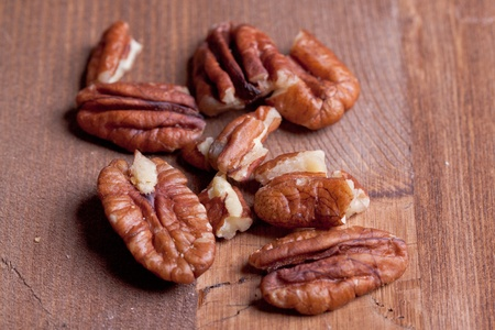 anti oxidants: Bunch of pecan nuts on wooden background