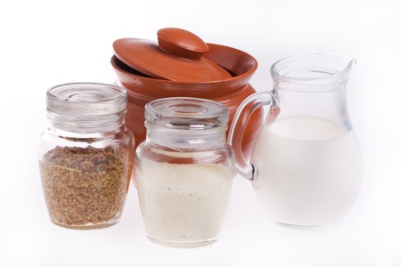 Tow glass jars of mustard and mayonnaise isolated over white photo
