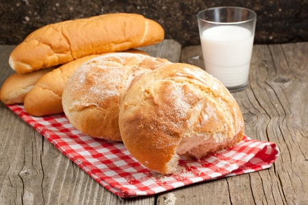 Group of fresh bread with glass of milk on old wooden table Stock Photo - 9239136