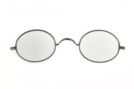Old vintage eyeglasses isolated over white