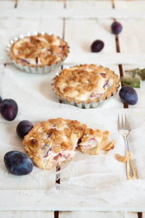Delicious little tarts with fresh plums photo
