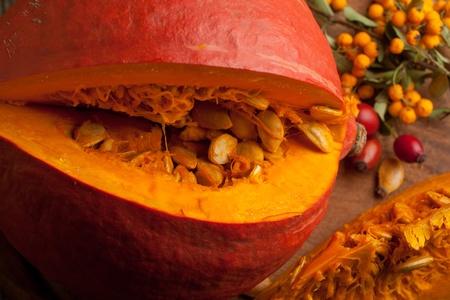 Sliced orange pumpkin with seeds photo