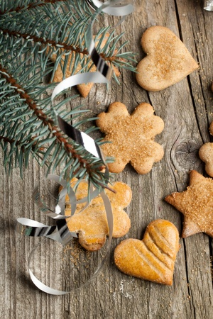 Top view on homemade sugar cookies with christmas tree on old wooden table photo