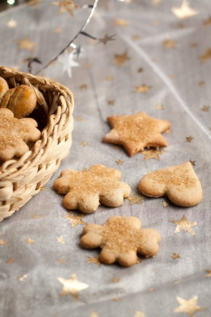 Homemade sugar cookies on white cloth with golden star photo