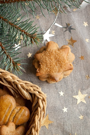 Top view on homemade sugar cookies with christmas tree and golden stars photo