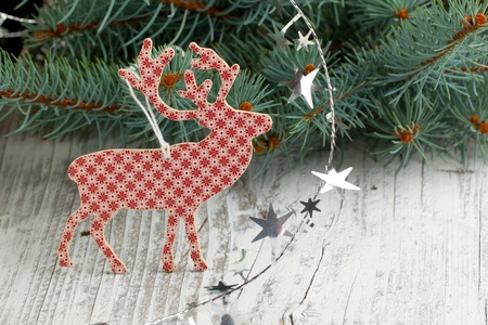 White-red christmas deer with a christmas tree and silver stars photo