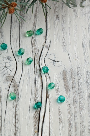 Green beads on old wooden table photo