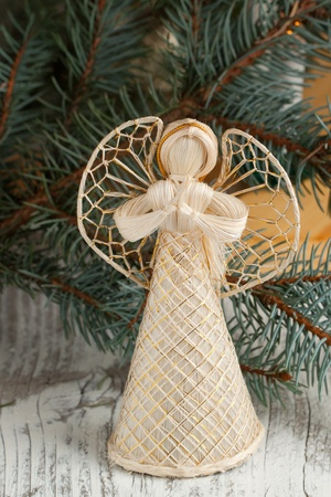 Christmas angel figurine on old wooden table photo