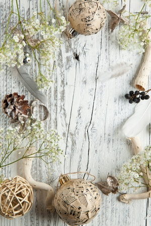 Background with white gypsophila flowers and christmas toys on white wood photo