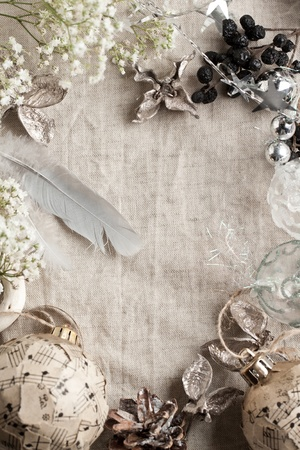 Background with white gypsophila flowers and christmas toys on linen cloth photo