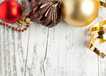 Background with christmas toys on white wooden table photo