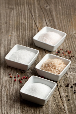 Various of salt and pepper on old wooden table Stock Photo - 11898328