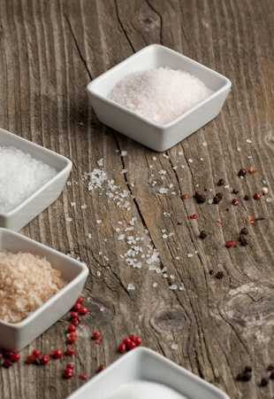 Various of salt and pepper on old wooden table Stock Photo - 11898283