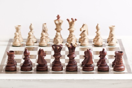 Black and white chess figures on chess desk Stock Photo - 12085005