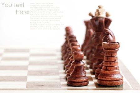 Black chess figures on chess desk photo